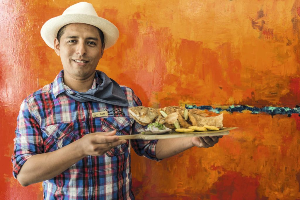 Montechristi Golf Club-Luis serving Camotillo Frito-Fried Fish served with plantains&rice salad-4117