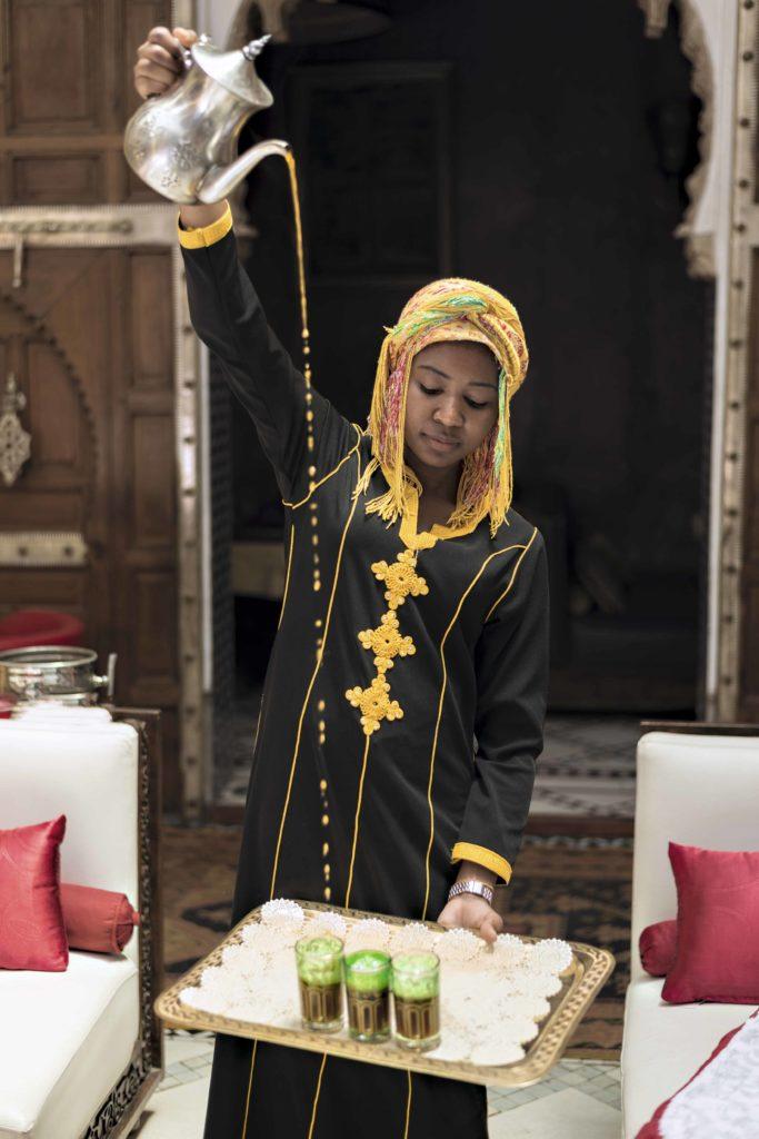 Dinerjat Restaurant-Waitress pouring tea-4290